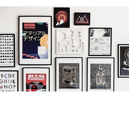 prints hanging on wall