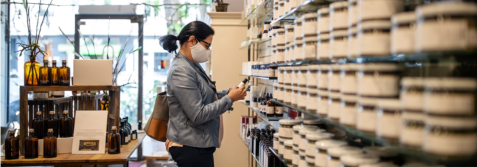 masked woman shopping in store