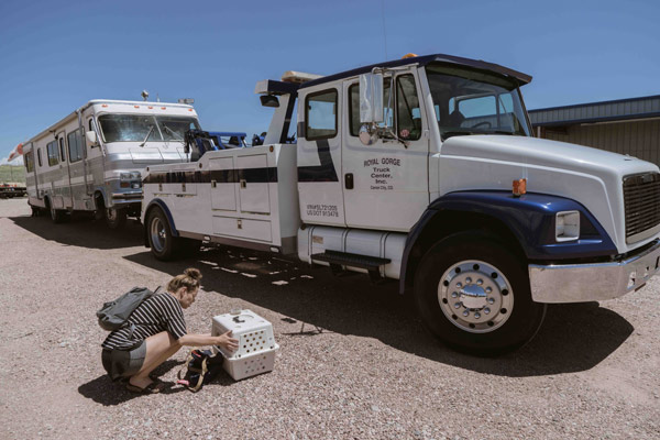 Tow truck towing RV